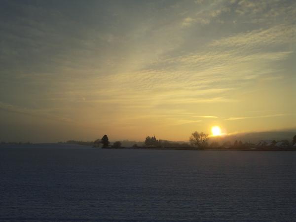 Coucher soleil neige